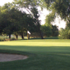 A sunny day view of a green at Mather Golf Course.