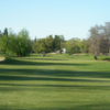A sunny day view of a green at Dry Creek Ranch Golf Course.