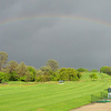 A view of rainbow over the driving range at Bass Lake Golf Course