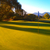 A sunny view of green with cart path in background (courtesy of Diablo Creek Golf Course)