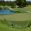 A view of a green protected by bunkers at Brentwood Country Club