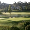 A view of green with water in background (courtesy of Del Mar Country Club)