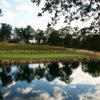 A view over the water of green at Gold Hills Country Club