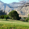 A view of a tee with mountains in background at Kern Valley Golf Course