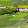 A spring view of a green protected by sand traps at Bella Collina Towne & Golf Club
