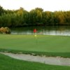 A view of a green with water coming into play at Wildhorse Golf Course