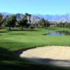 A view of a green guarded by bunkers at Rancho Mirage Country Club