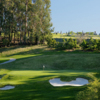 A view of a green surrounded by bunkers at Claremont Country Club
