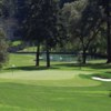 A view of a green with water in background at Meadowood Resort Hotel