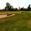 A view of a green protected by bunkers at Alondra Park Golf Course