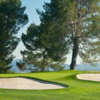 A view of a green protected by bunkers at Porter Valley Country Club (ClubCorp)