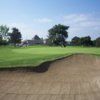 A view of hole #18 guarded by a large bunker at Classic Course from Mile Square Golf Course