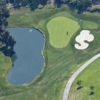Aerial view of a green protected by a pond and a bunker at Mission Viejo Country Club