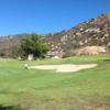A view of a green protected by a bunker at Welk Resort San Diego