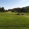 A view from a tee with a bridge on the righ side at Pala Mesa Resort