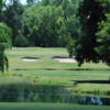 A view of a green surrounded by sand traps at North Ridge Country Club