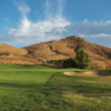 View of a green and bunker at Hidden Valley Golf Club