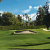 A view of a green protected by bunkers at Redlands Country Club