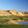 A view of green with water on the right at Course at Wente Vineyards
