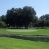 A green view with bunkers on the left at El Dorado Park Golf Club