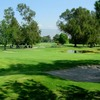 A view of green surrounded by bunkers at San Bernardino Golf Club