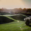 A sunny day view of a green at Bella Collina Towne & Golf Club