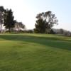 A sunny day view of a hole at Mission Bay Golf Course.