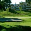 A sunny day view of a hole at San Vicente Golf Resort.