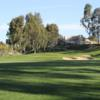 A view of a hole and the clubhouse in background at Tijeras Creek Golf Club.