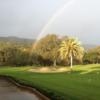 A view of the rainbow over a hole and the putting green at Castlewood Country Club.