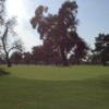 A sunny day view of a green at Willowick Golf Course.
