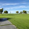 A sunny day view of a fairway at Blythe Golf Course.