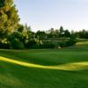 A sunny day view of a green at Jurupa Hills Country Club.