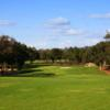 A sunny day view of a hole at Turkey Creek Golf Club.