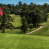 A sunny day view of a hole at Lake Chabot Municipal Golf Course.