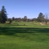A sunny day view of a green at Napa Golf Course from Kennedy Park