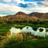 A view of a green with water and bunkers coming into play at Desert Course from The Vintage Club.