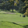 A sunny day view of a hole at Indian Hills Golf Club.