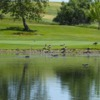 View of a green over a pond at Teleli Golf Club.