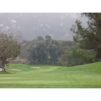 No. 2 on Temecula Creek Inn's Oaks nine snakes around massive trees to a green set into the foot of the mountains.
