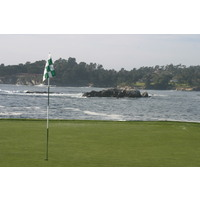 The Pebble Beach Golf Links web site recommends playing it safe by knocking down a short iron and keeping  the ball from ballooning in the wind on the par-3 seventh hole.