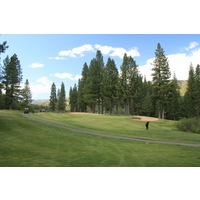 The 11th hole at Plumas Pines Golf Resort is a par 3 with two bunkers.