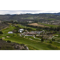 An aerial view of the clubhouse, parking lot and part of the course at Tierra Rejada Golf Club.