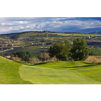 A panoramic view of the surroundings, with the part of a fairway in the foreground, at Tierra Rejada Golf Club.