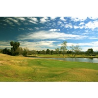 The 18th hole at Carlton Oaks Lodge & Country Club is a long par 4 that plays over water.
