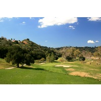 The sixth hole is a short par 3 that heads downhill from an elevated tee on the Oak Glen Course at Sycuan Golf Resort.