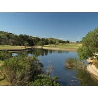 A lake separates the eighth and ninth holes at Maderas Golf Club in Poway, California.
