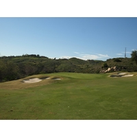 The par-4 11th green at Maderas Golf Club is perched on a ridge.