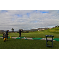Golfers work on their game on the driving range at Twin Oaks Golf Course.