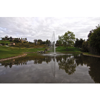 A lake with a fountain is one of the hazards at the ninth, the signature hole at Twin Oaks Golf Course.